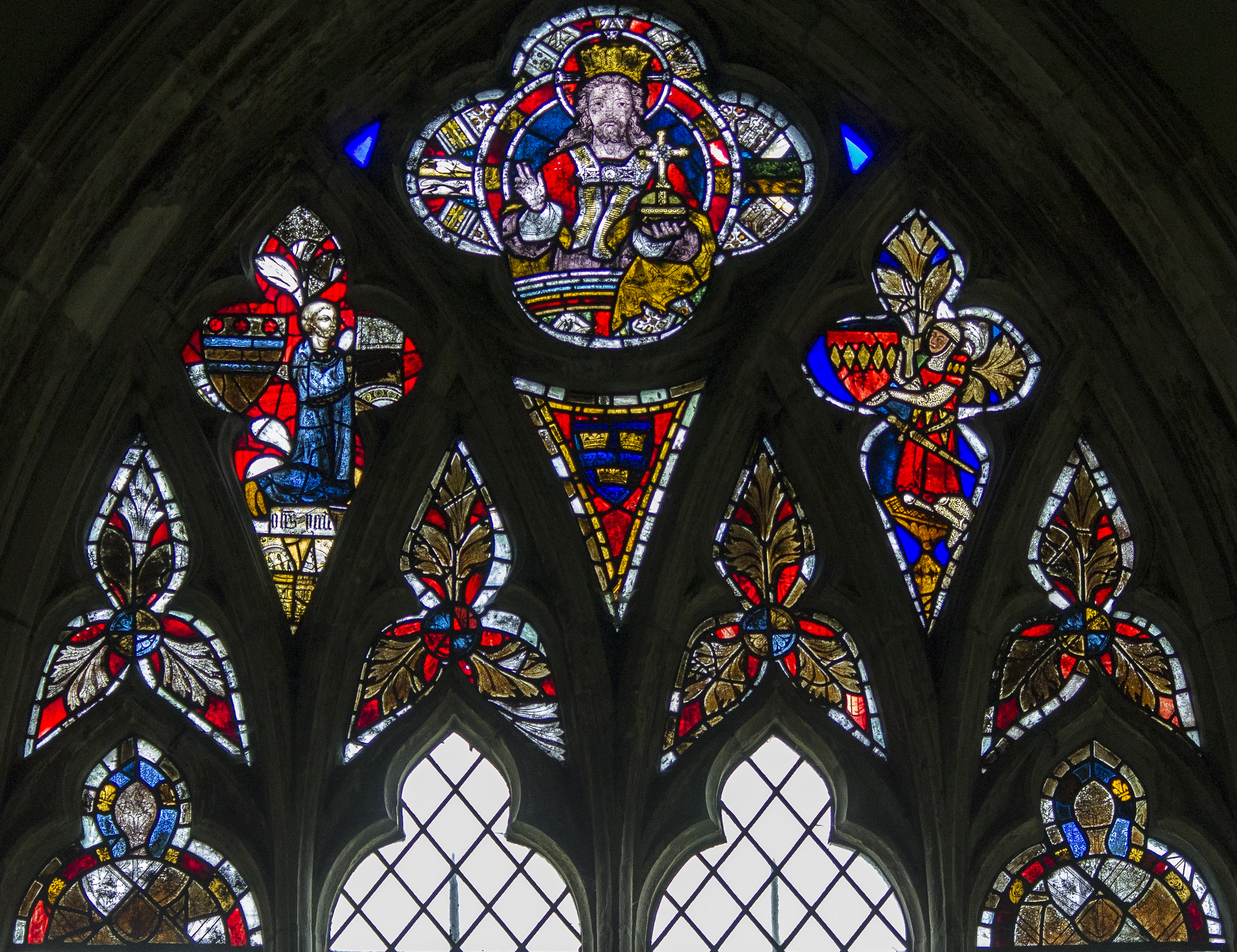 The Newmarch Window at Carlton-Scroop church in north Lincolnshire. The figure dressed as a knight on the right was Sir John de Newmarch in about 1307. Photo courtesy of J. Hannan-Briggs. Click or tap the picture to enlarge it.
